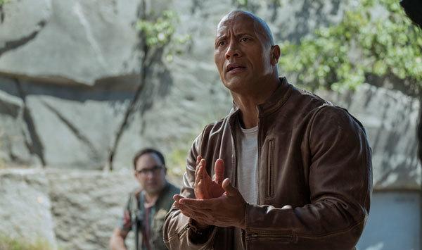 Dwayne as Davis speaks sign language with George
