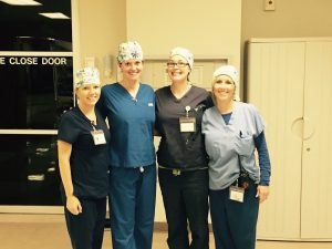 4 nurses with cute surgical hats