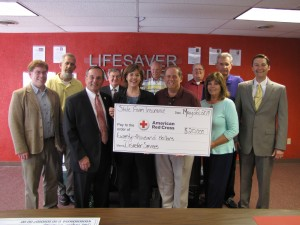 State Farm presenting the American Red Cross Heart of Missouri Chapter with a grant for $20,000.  Left to right: Kevin Gamble, State Farm public affairs specialist; Mark Rehagen, chapter board member; Dave Griffith, chapter executive director; Kent Trimble, chapter board member; Nancy Sell, chapter major gifts officer; Jim Schulte, chapter board member; Brad Hutchison, Jefferson City State Farm agent; Ralph Robinette, chapter board member; Trudy Sommers, Jefferson City State Farm agent; Bob McDonough, Jefferson City State Farm agent; Ryan Kenney, State Farm sales leader.