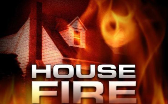 A home is damaged by fire, North of Queen City
