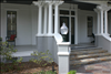 Select Cypress porch floor finishes a beautiful old Texas home.