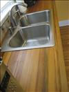 Sinker Cypress for kitchen countertop with tung oil finish.