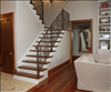 Elegant Common & Select mix of reclaimed Longleaf Pine 1x8 floors and stair treads.