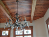 Beautiful stained Cypress V-Joint ceiling and 6x10 beams