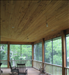Pecky Cypress ceilings creates a casual porch setting.