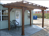 Common Cypress Shade Arbor 10'x16' with light brown stain.