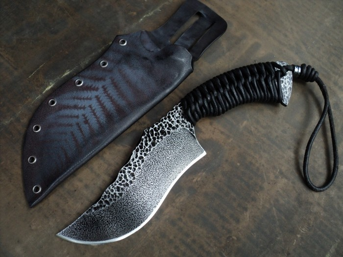 For $700 or more, you receive this beautiful SK1 Knife by Sage Blades, the perfect bush tool for the jungle or camping. Handcrafted with O1 Tool Steel in a micro-peened finish and a leather-cord handle-wrap with a kydex sheath.