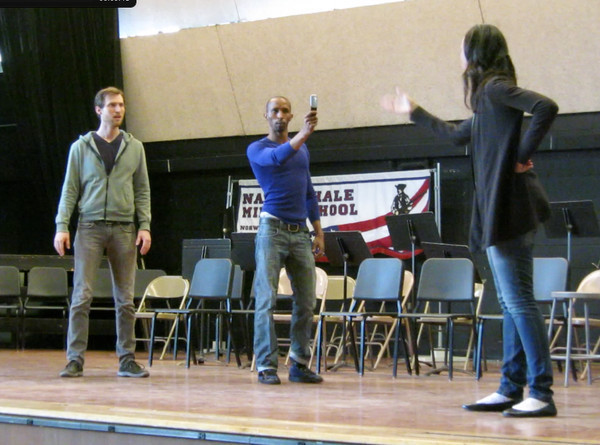 Actors from the pilot program of Speaking Daggers use cell phones in a scene from A Midsummer Night's Dream to showcase cyber-bullying.