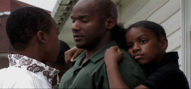 "Thomas Gant shares a quiet moment with two of his children minutes before his ""trailer"" visit ends."
