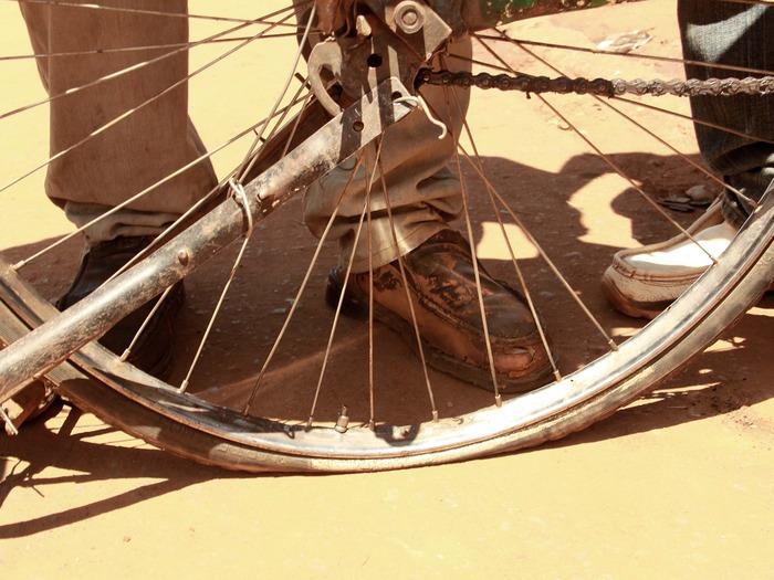 A boda boda with a flat tire