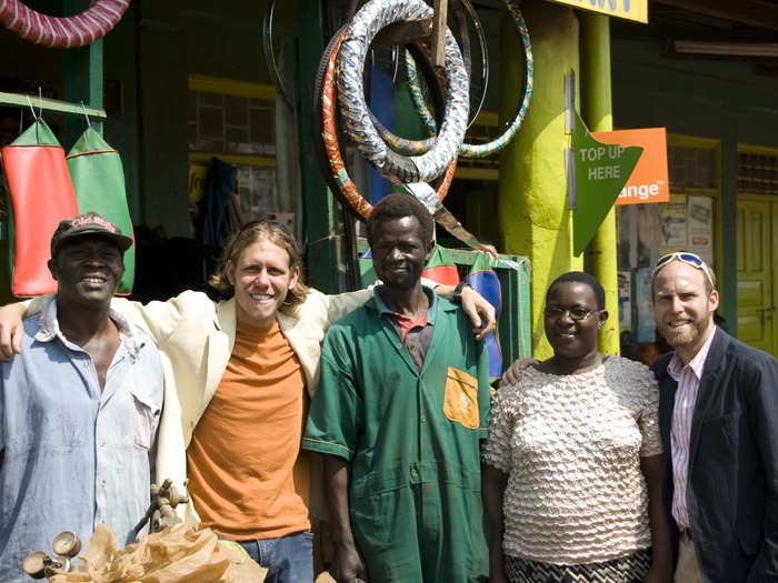 The Baisikeli Ugunduzi team (Kabole, Ben, Joseph, Susan, and John) in front of New Generation Cycle Mart, the first to carry our tubes.  Jackie and Owen are busy taking photos.