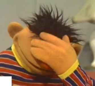 Sesame Street's Ernie in classic facepalm pose