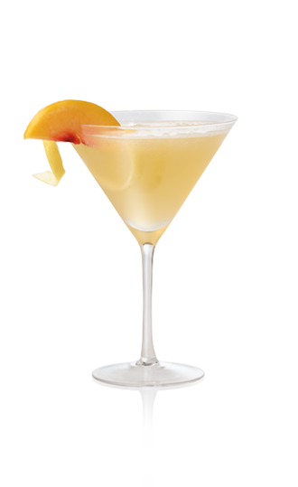 Glass of sparkling peach cocktail