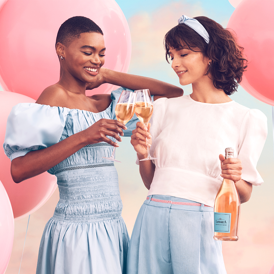 Two Women Toasting with La Marca Prosecco Rosé