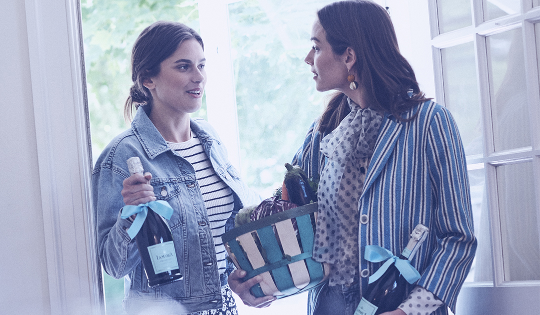Women arriving with La Marca Prosecco as a gift