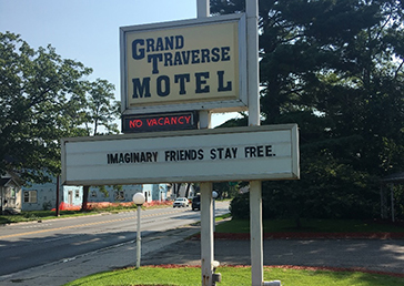 "Motel sign: ""Imaginary friends stay free"""