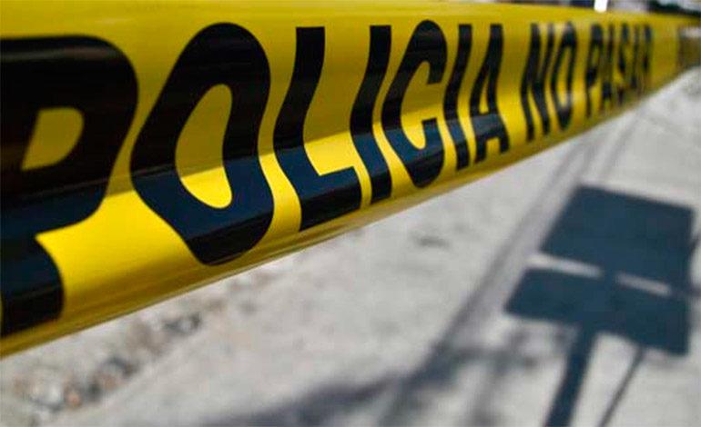 """Botan cadáver en calle de San Pedro Sula y le dejan rótulo: """"Por extorsionador"""""""