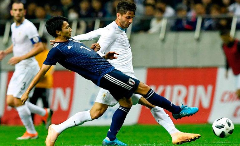 Japón puede con Uruguay en un intenso intercambio de golpes