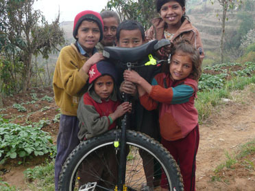 Nepalese kids marvel at a unicycle