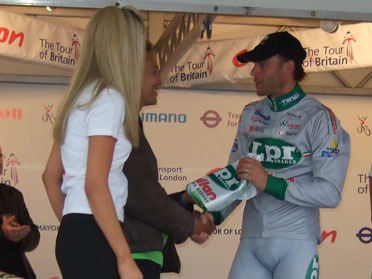 Koy Thomson, chief executive of LCC, presents a trophy to the winner of the London stage of the Tour of Britain