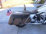 Rk1rk_bomber_brown___black_shark__saddlebag_guard_right_on_road_king