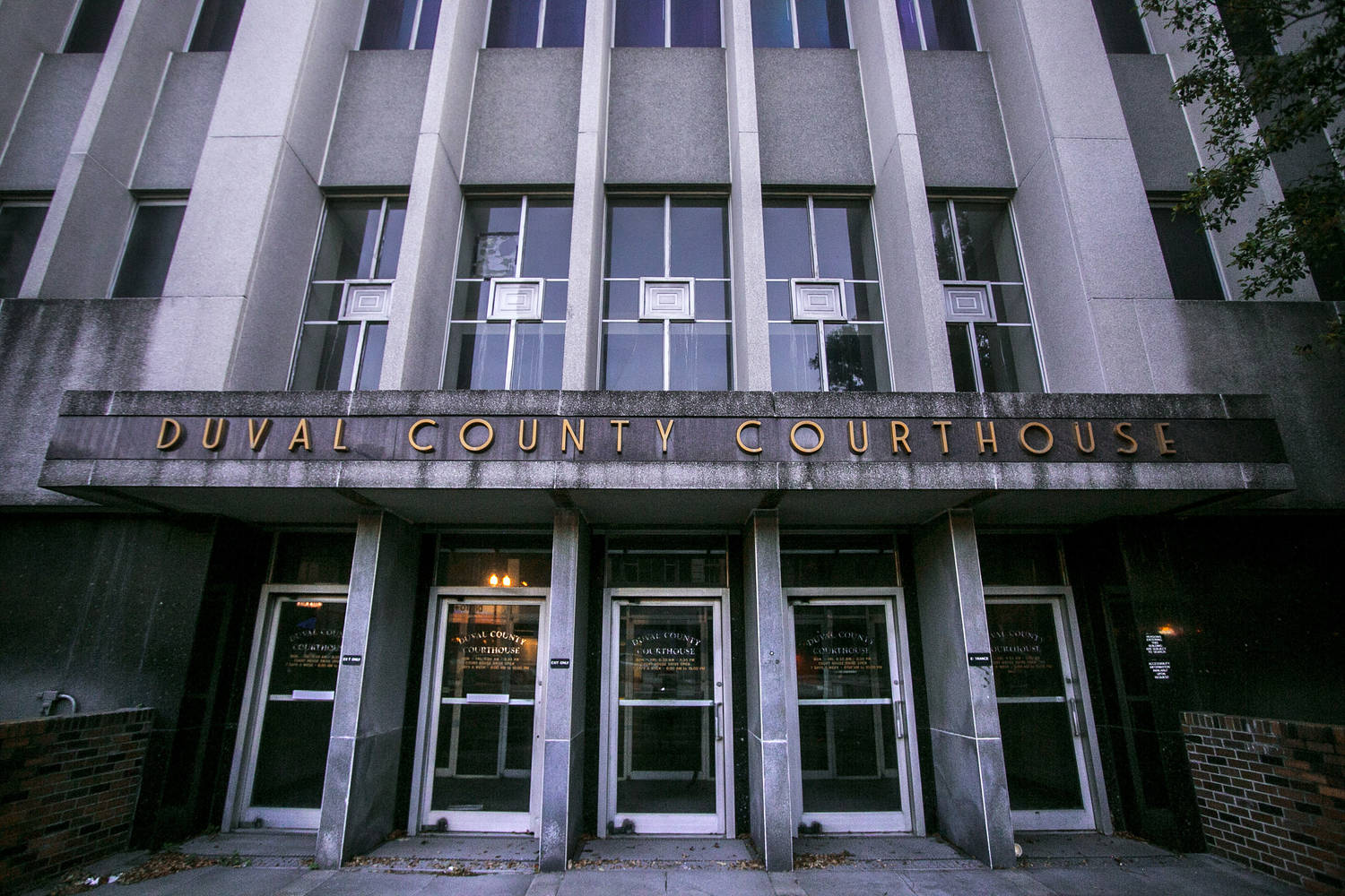 DUVAL COUNTY COURTHOUSE it says in brass-colored letters above the entrance to a grim gray building.