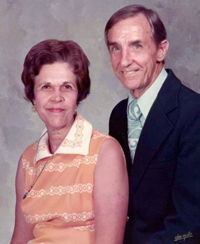 A smiling couple posed for a portrait together.