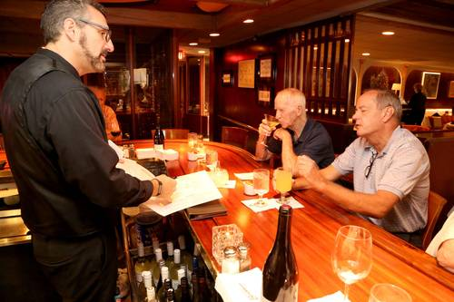 Bartender Matthew Mescato, left, takes orders.   [DOUGLAS R. CLIFFORD  |  Times]