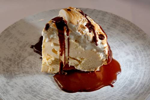 Baked Alaska meringue pie with Heilman hot fudge  [DOUGLAS R. CLIFFORD  |  Times]