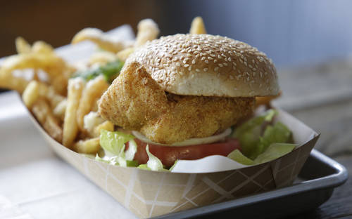 Fried grouper sandwich. [JAMES BORCHUCK  | Times]