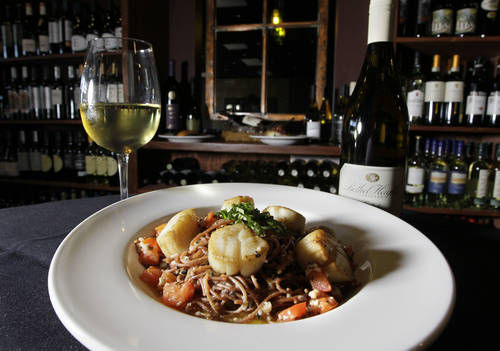 Red wine- and black pepper-infused capellini in oil and garlic served with seared scallops  [Times file]