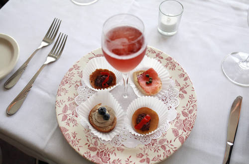 Kir royale and appetizers  [LARA CERRI  |  Times]