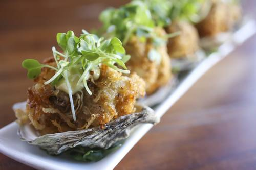 Potato-crusted oysters with dill pickle nectar, house dijonnaise, micro dijon  [EVE EDELHEIT  |  Times]