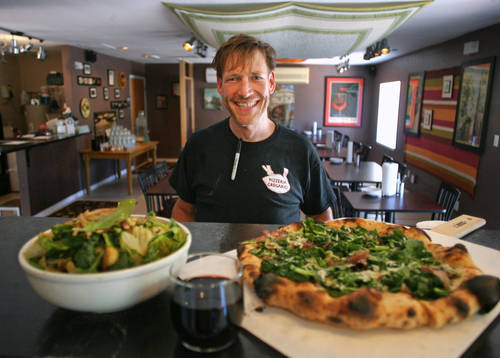 Wood-fired pizza [JIM DAMASKE  |  Times]