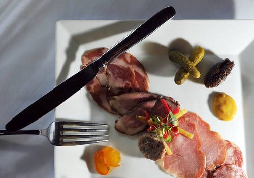 House-cured charcuterie plate  [CHRIS URSO  |  Times]