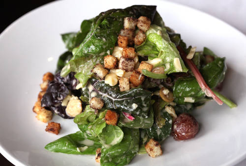 A salad made of local greens  [LARA CERRI  |  Times]