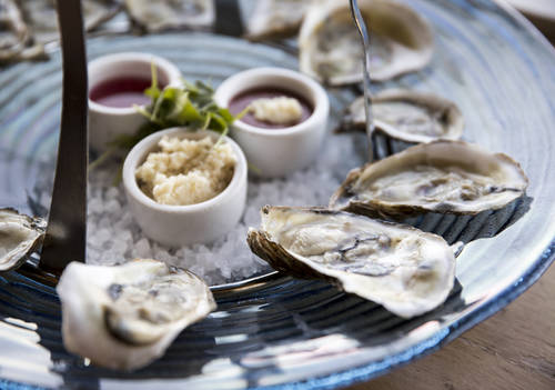 Oysters on the half shell on a seafood tower  [MONICA HERNDON  |  Times]