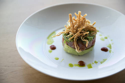 Ahi poke has ahi tuna, avocado, wakame salad, chile dressing, sriracha and olive oil  [MONICA HERNDON  |  Times]