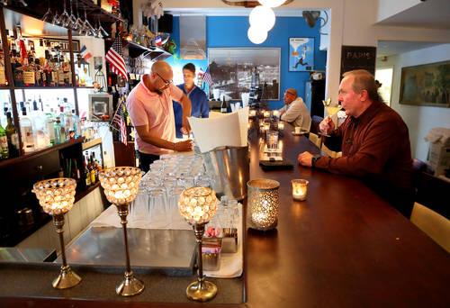 Bartender Sonny Tanco, left, prepares cocktails. [DOUGLAS R. CLIFFORD  |  Times]