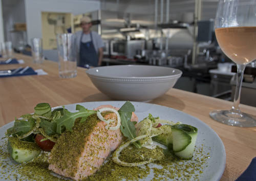Salmon is paired with fennel, tomatoes, cucumber and pistachio.  [JIM DAMASKE  |  Times]