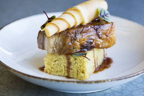 Pork belly with cornbread, spiced honey and pickled apple  [EVE EDELHEIT  |  Times]