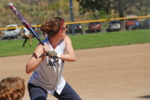 Woman hitting softball