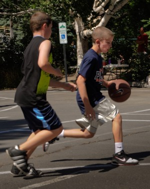 Boy dribbling basketball