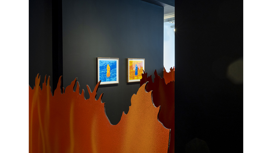 Tom Pnini: Two Figures in a Field (installation view with flames and silkscreen prints)
