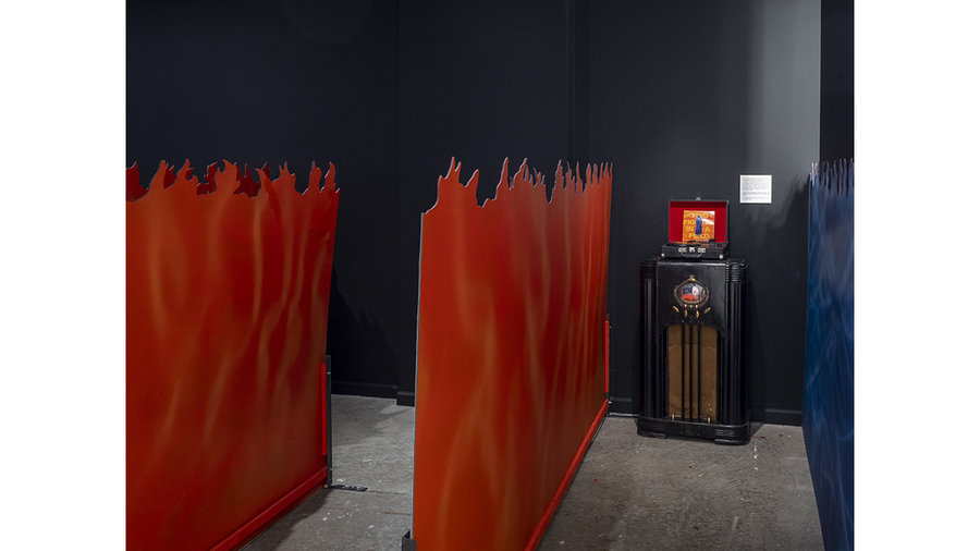 Tom Pnini: Two Figures in a Field (installation view with flames and second record player)