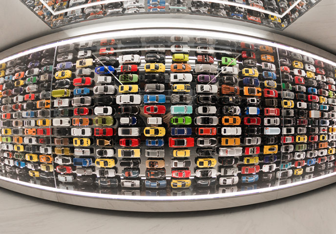Admittedly, the car connection is clear within the discrete mirrored confines of the second floor lavatory, with hundreds of colorful toy cars (no, not all Lexus) playfully parked in neat rows on the ceiling.