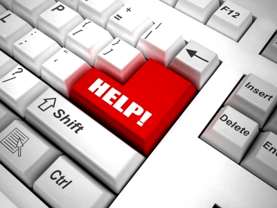 "Image of computer keyboard with bright red key labelled ""HELP!"""