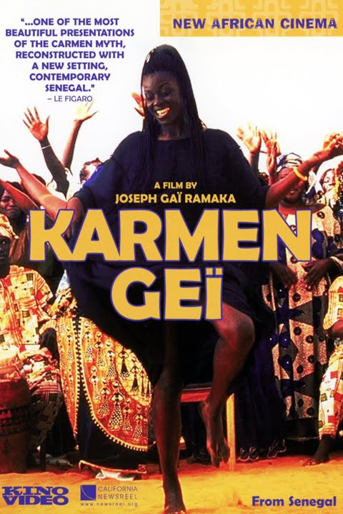 "Film poster for the movie Karmen Gei and has a picture of a woman dancing in front of a crowd with their arms in the air. Quote on the poster says, ""...One of the most beautiful presentations of the Carmen myth reconstructed with a new setting, contemporary Senegal. - Le Figaro"""