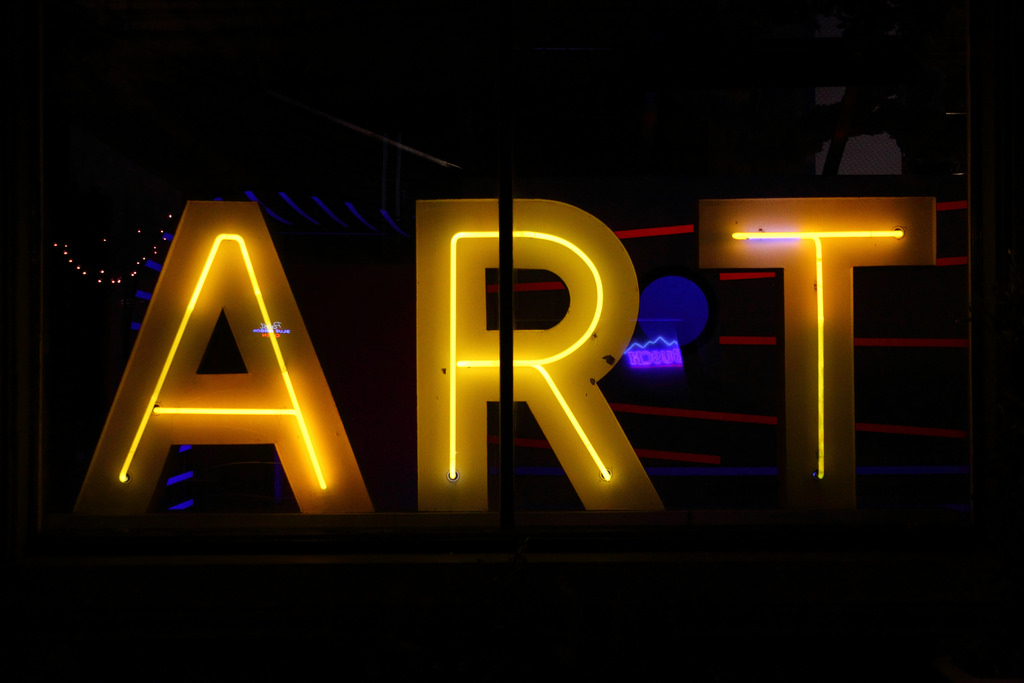 """ART"" written in yellow neon letters"