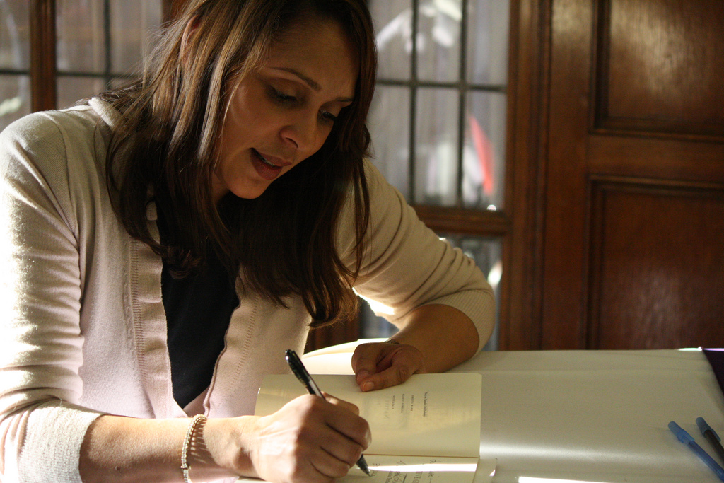 Pulitzer Prize winning poet Natasha Trethewey signs a copy of her book Native Guard at the University of Michigan. Picture by Jalissa Gray.